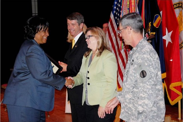 Nellie Herbin receives a Certificate of Achievement in recognition of her 49 years of public service during the Annual Public Service Recognition Ceremony. Pictured from left to right: Rendon, Congressman Rob Wittman of Virginia's 1st District; Julie Gifford, Military Liaison for Hampton Roads, Office of the Secretary of Veteran's Affairs and Homeland Security from the State of Virginia; Lt. Gen. John Sterling, Deputy Chief of Staff, U.S. Army Training and Doctrine Command.