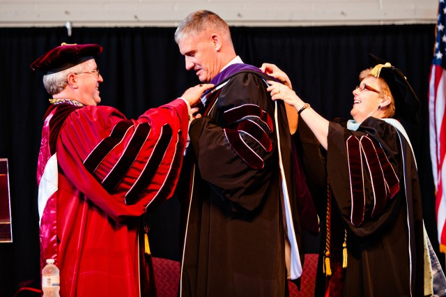Gen. David M. Rodriguez, commander U.S. Army Forces command,  is hooded by Doug Whitlock (left), the president of Eastern Kentucky University, and EKU Provost Dr. Janna Vice as part of the ceremony conferring an honorary doctor of laws degree on Rodriguez, May 4, 2012, at Eastern Kentucky University in Richmond, Ky.