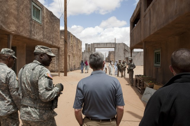 Col. David M. Hamilton, Commander,212th Fire Brigade briefs Secretary of the Army John McHugh on the situational training exercise being conducted at site Kamal Jabour, Fort Bliss, Texas, May 8, 2012.  Maj. Gen. Dana J.H. Pittard, Commander, 1st Armored Division accompanied McHugh to the simulated Afghan village that resembles Madina Wasl at Fort Irwin's National Training Center (U.S. Army photo by Spc. John G. Martinez)