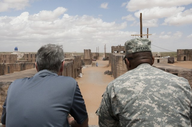 Secretary of the Army John McHugh and Maj. Gen. Dana J.H. Pittard, Commander, 1st Armored Division, observe a situational training exercise at site Kamal Jabour , Fort Bliss, Texas, May 8, 2012.  Soldiers train in realistic environments to assist them in preparing for future operations and enable leadership to evaluate a unit's readiness.