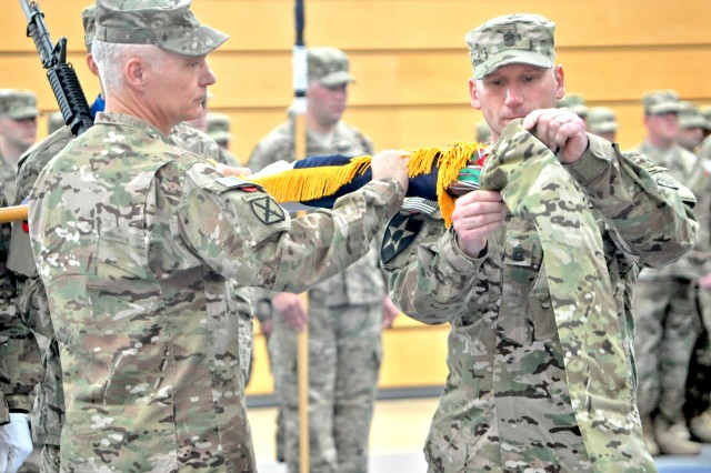 Lt. Gen. James Terry (left), V Corps commander, and V Corps Command Sgt. Maj. William Johnson case the colors in a ceremony in Wiesbaden, Germany, May 10, 2012, in preparation for the corps' deployment to Afghanistan.