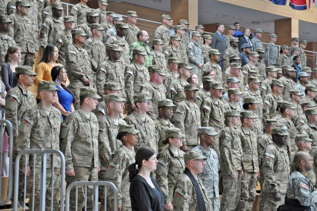 Soldiers, civilians and family members take part in the V Corps casing ceremony in Wiesbaden, Germany, May 10, 2012.