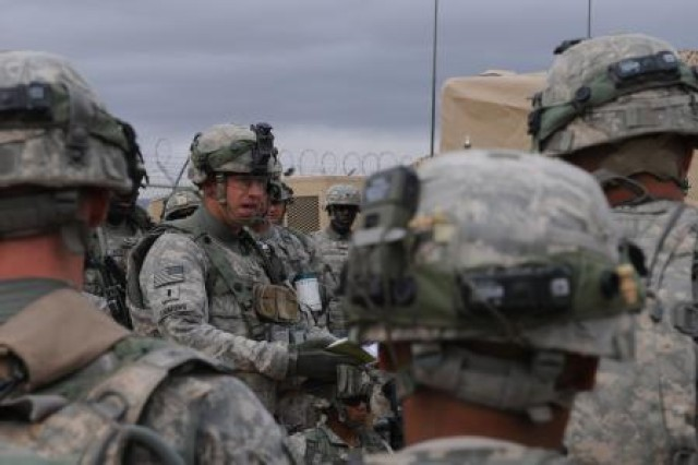 First Lt. Chris Emmons of Company B, 1st Battalion, 35th Armored Regiment, 2nd Heavy Brigade Combat Team, 1st Armored Division, based out of Fort Bliss, Texas, gives his Soldiers a convoy patrol brief prior to their reconnaissance mission at Network Integration Evaluation 12.2, May 8, 2012.