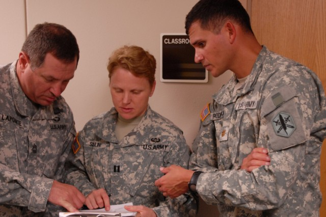 Master Sgt. Paul Lapointe, Civil Affairs Mission Operations Center noncommissioned officer, 81st Civil Affairs Battalion, and Capt. Tammy Sloulin, team leader, 81st Civil Affairs Battalion, discuss some assessment results at Thomas Moore Clinic at Fort Hood, Texas, May 1, 2012, as Maj. Edgard Rodriguez, the Civil Information Management chief with 85th Civil Affairs Brigade, provides guidance.  The Soldiers were part of a Civil Information Management class that included practical exercises in the assessment of civil facilities.