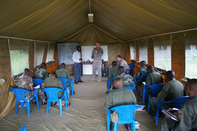 U.S. explosive ordnance disposal (EOD) instructors with the Humanitarian Mine Action program teaches a portion on ordnance identification, to a group of Congolese soldiers with the Forces Armées de la République Démocratique du Congo (FARDC) . The main objective of this exercise is to improve the FARDC deminers' EOD skill sets to a point where they can set up a sustainable program in the DRC and to improve relations between the DRC and the United States.
