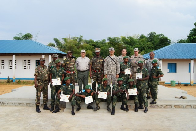 A Group photo of all the participants during a train-the-trainer (TTT) course with Soldiers of the 184th Ordnance Battalion (EOD), out of Fort Campbell, Ky. and the Forces Armées de la République Démocratique du Congo (FARDC) deminers.