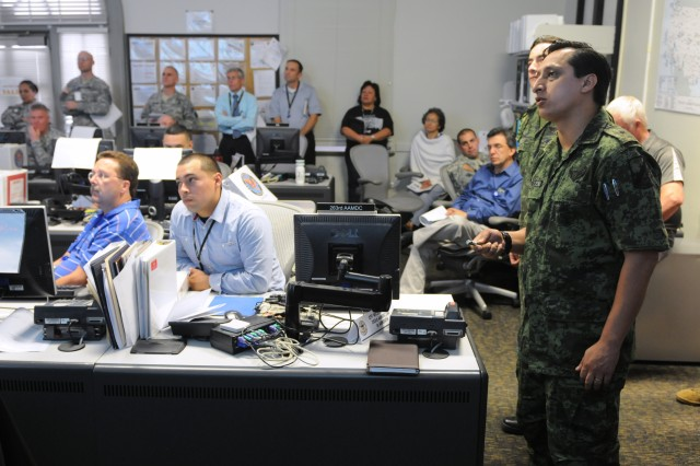 Mexican military liaison officers from the National Defense Secretariat, or SEDENA, 4th Military Region, which encompasses the Mexican states of Nuevo Leon, Tamaulipas and San Luis Potosi, brief members of U.S. Army North's Main Command Post at Fort Sam Houston, Texas, May 6, 2012, on the progress of Mexican hurricane response efforts during Ardent Sentry 12, a defense support to civil authority exercise directed by the Joint Chiefs of Staff and executed by Army North and SEDENA's 4th Military Region.