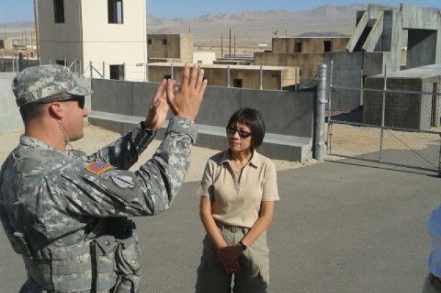 Army Acquisition Executive Heidi Shyu talks to 1st Lt. Michael Keyser at Fort Irwin's National Urban Warfare Center. Shyu spent several days attending briefings and meeting with Soldiers and leaders at the National Training Center, where Soldiers experience extensive simulation and live-fire training in preparation for deployment; training scenarios and learning experiences are designed to replicate conditions, tactics, techniques and procedures from recent theater experiences and also anticipate potential future threats.