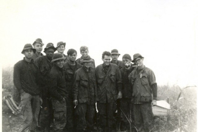 Gathering on Christmas Day 1969, members of Spc. 4 Leslie H. Sabo's platoon in B Company, 3/506th Infantry, 101st Airborne Division, pose in Vietnam.