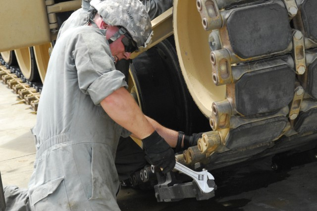 Pfc. Mark Backer, loader for the 2nd Brigade, 1st Armored Division, tank crew out of Fort Bliss, Texas, competes in the Maintenance Challenge May 7.