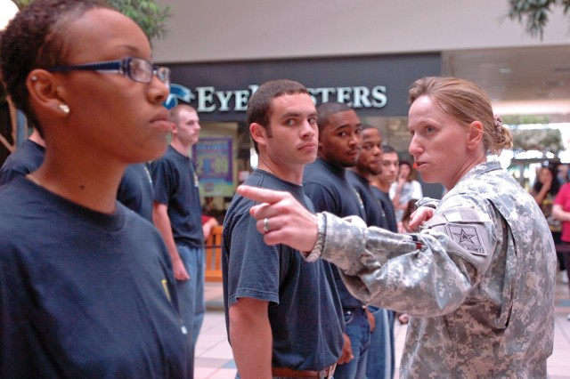 Staff Sgt. Heather Hathaway, a recruiter at the Temple, Texas, recruiting station, tells future Soldiers how to properly align themselves in a platoon formation Sept. 9, 2010, before an Oath of Enlistment ceremony.