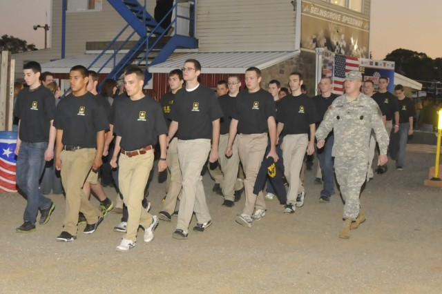 Sgt. 1st Class Troy Ramsey (right) marches future Soldiers to an event Sept. 17 in Selinsgrove, Pa. About 30 enlisted at the event.