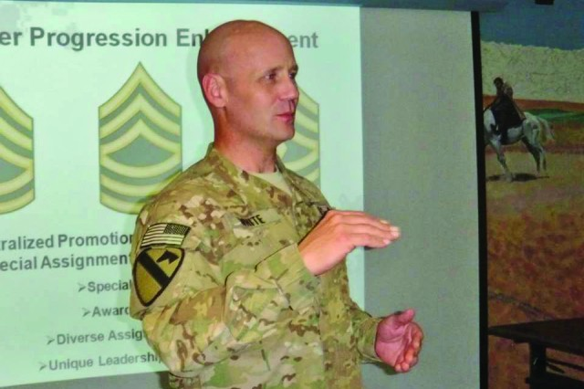 Sgt. 1st Class Jeff White, the 1st Cavalry Division's recruiting outreach NCO, gives a presentation at the hospital on Bagram Air Field in Afghanistan.