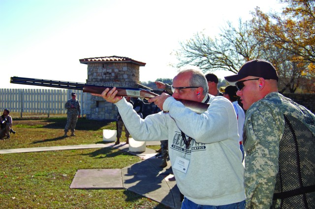 Raul Mas, an investment company executive and South Florida Army Advisory Board member, shoots with the U.S. Army Marksmanship Unit during a marksmanship clinic. Recruiters use these interactions to build rapport with community leaders.