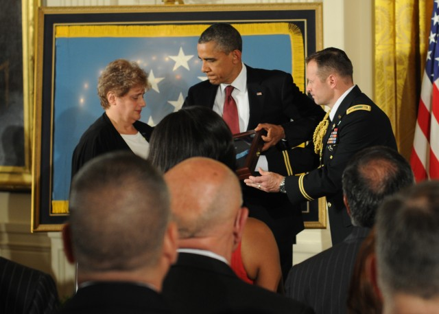 President gives Medal of Honor to Vietnam hero's widow