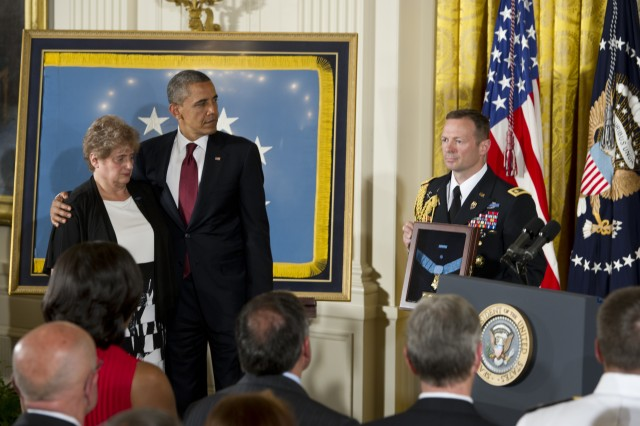 Rose Mary Brown, widow of Spc. 4 Leslie H. Sabo Jr., 101st Airborne Division, accepts Sabo's Congressional Medal of Honor at the White House in Washington May 16, 2012. Sabo was killed in action on May 10, 1970.