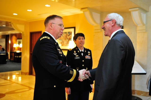 Army Chief of Chaplains Maj. Gen. Donald L. Rutherford greets George Sabo, brother of Specialist 4 Leslie H. Sabo Jr. at the Sheraton National Hotel, prior to the White House Medal of Honor ceremony, posthumously, in honor of Spc. 4 Sabo. Then 22-year-old Sabo was killed in action in Cambodia in 1970 while saving the lives of his fellow solders. Washington D.C., May 16, 2012.
