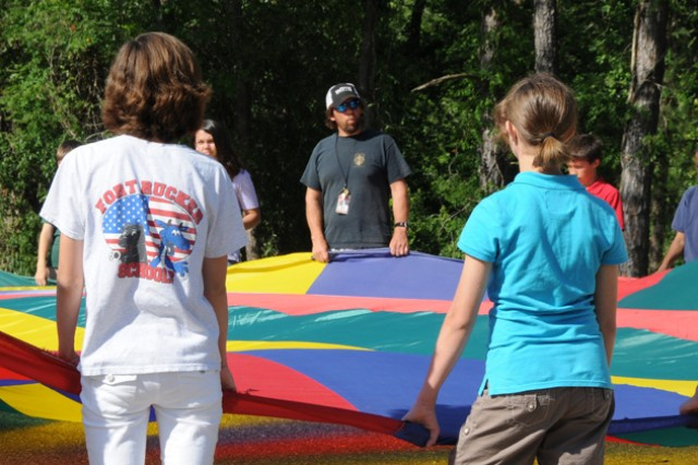 Jim Fenn, a physical education teacher, explains how the parachute activities demonstrate the principles of wind energy.