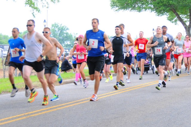 Individual and relay runners race off the starting line during the Fort Rucker Army 10-Miler behind the Fort Rucker Physical Fitness Facility May 12.