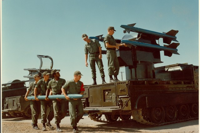 Six Advanced Individual Training Soldiers from the 6th Air Defense Artillery Brigade learn how to load AIM-9 Sidewinder missiles on the M48 Chaparral self-propelled Forward Air-Defense System at Fort Bliss, Texas, in this 1981 photo. The Chaparral system used doppler radar and an infrared homing guidance system to engage enemy fixed and rotary-wing targets. It remained operational in the Army until 1997.
