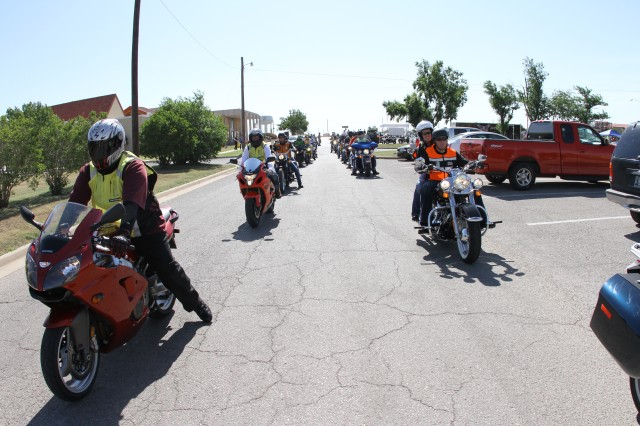 A group of about 30 motorcyclists line up at the start of Fort Sill's Seventh Annual Freedom's Thunder motorcycle safety rally and ride May 10 near the Impact Zone. Road captains monitored their respective groups to ensure everyone was riding safely.