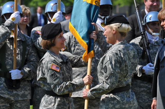 Maj. Gen. Camille Nichols accepts the U.S. Army Contracting Command flag from Gen. Ann Dunwoody during the assumption of command ceremony.