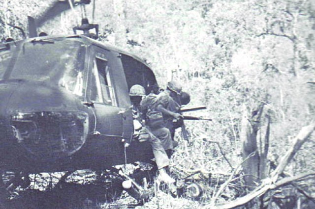 Specialist 4 Denny Kirkham jumps out of a helicopter in Vietnam in 1970. Kirkham, only 18 years old when drafted after graduation, earned a Bronze Star for his duties as a radio operator during the Battle of Fire Support Base Ripcord in the A Shau Valley, the only battle lost by the 101st Airborne Division in Vietnam.