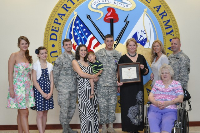 FORT BRAGG, N.C. (May 17, 2012)   Purple Heart Award recipient Sgt. Tyler Josey (center) stands with his Family. To his right are sisters, Heather Hyde and Mikaela Maloy; his brother, Air Force Staff Sgt. Connor Maloy; his wife, Brittany Josey; and their son, Levi Josey. To his left are Josey's mother, Reba Josey; his stepmother, Jennifer Maloy; his grandmother, Nancy Josey; and his father, Lt. Col. Sean Maloy, who serves as the executive officer for the FORSCOM deputy chief of staff.