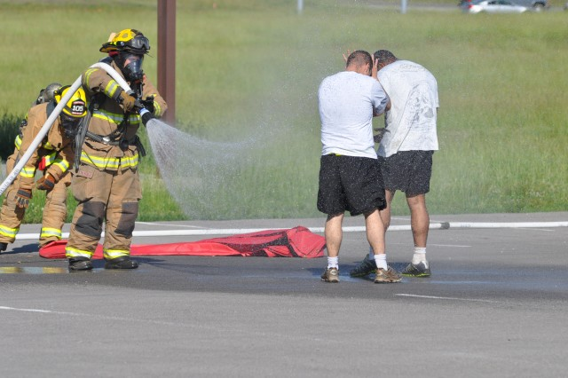 "During Fort Campbell's annual Full-Scale Anti-terrorism Exercise, a Radioactive Dispersal Device, commonly referred to as a ""dirty bomb,"" detonated in a car located at the Division Parade Field parking lot, uniting both on and off post agencies to respond to the incident, May 10, 2012. Firefighters decontaminate role players during the scenario, May 10."