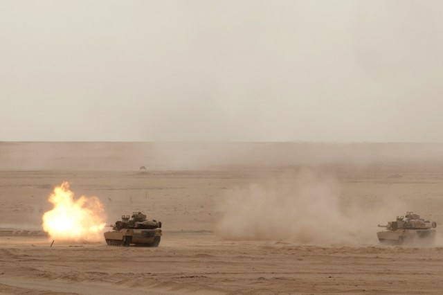 M1A2 Abrams Tanks of the 2nd Combined Arms Battalion, 8th Cavalry engage targets during a Combined-Arms Live-Fire Exercise with the Kuwaiti Army's 151st Tank Battalion, 15th Mubarak Armored Brigade, at northern Kuwait's Udari Range, May 8, 2012. The 2nd Combined Arms Battalion belongs to the 1st Brigade Combat Team, 1st Cavalry Division (Iron Horse). The exercise also involved the brigade's 1st Battalion, 82nd Field Artillery, the brigade headquarters, and the 29th Combat Aviation Brigade.