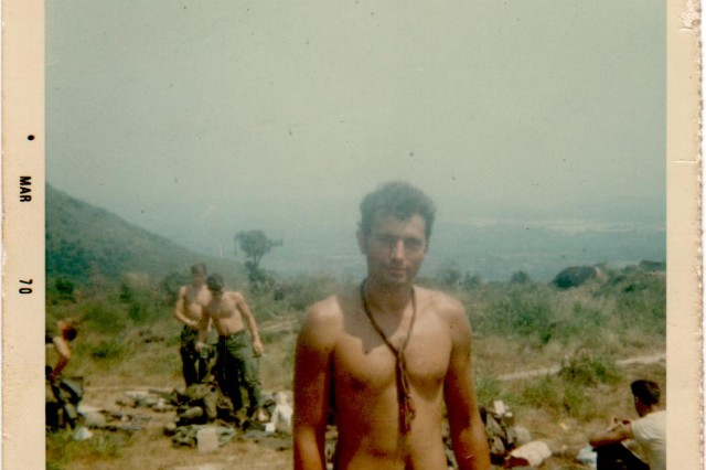 "Spc. Leslie Sabo and his ""family,"" otherwise known as the boys of Bravo Company, 3rd Battlaion, 506th Infantry, 101st Airborne Division, have reached a summit before the big battle at Se San, Cambodia, May 10, 1970, during the Vietnam War."