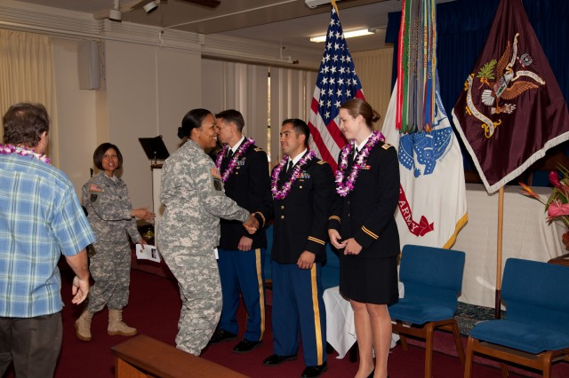 HONOLULU - Col. Glenda Lock, deputy commander for nursing, Pacific Regional Medical Command and Tripler Army Medical Center, congratulates the students of Interservice Physician Assistant Program Class 10-2 after their graduation in the TAMC Chapel, here, May 14. The graduates pictured left to right are Capt. Rhett Soltas, Capt. Brian Gomez and Capt. Amanda Buchholz. They each received a Masters of Physician Assistant Studies degree from the University of Nebraska Medical Center, the affiliated academic institution for IPAP.