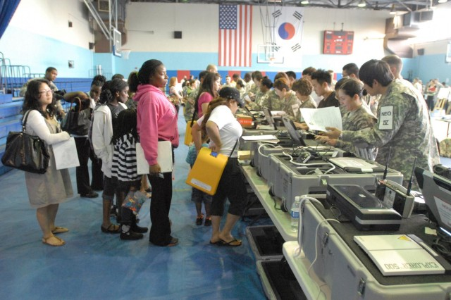 U.S. military dependents, contractors, retirees in Area 4 participate in the Courageous Channel exercise at the Kelly Fitness Center on Camp Walker from May 17 to 19 as a way to practice non-combatant evacuation operations.