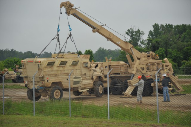 "As part of a capabilities demonstration May 16, 2012, the Multi-Mission Recovery System, a prototype system nicknamed ""The Beast,"" demonstrates lifting capability not previously available to Soldiers in the field. Various systems were used to demonstrate techniques for recovering (towing, winching or hosting) damaged or incapacitated vehicles, which are critical skills Soldiers develop through training courses taught at the facility."