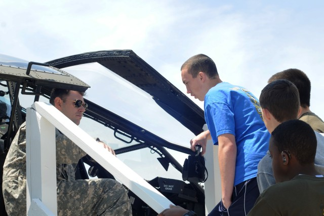 Capt. Ashley R. Perdue explains the AH-64D Apache to visitors during the 2012 Joint Service Open House at Joint Base Andrews, Md., May 18, 2012.