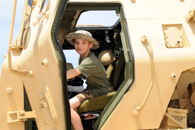 Gabriel, of Virginia, 10 years old, explores the cab of the M-142 High-Mobility Artillery Rocket System during the 2012 Joint Service Open House at Joint Base Andrews, Md., May 18, 2012.