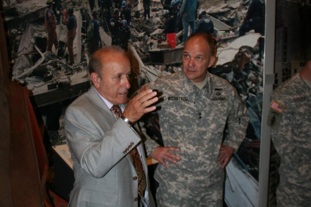NEW YORK -- Lee Ielpi, President of the WTC Tribute Center dicusses the response and recovery at ground zero with New York Army National Guard Maj. Gen. Steven Wickstrom May 18 during a guided tour of the WTC Tribute Center and Memorial site in honor of the New York National Guard's response and recovery efforts after 9/11. Wickstrom is the commander of the National Guard's 42nd Infantry Division, and Balfe the Deputy Division Commander. The 42nd Infantry was among the many New York National Guard elements to respond to ground zero in the days, weeks and months following the 9/11 attacks. U.S. Army photo by Lt. Col. Richard Goldenberg, NY Army National Guard.