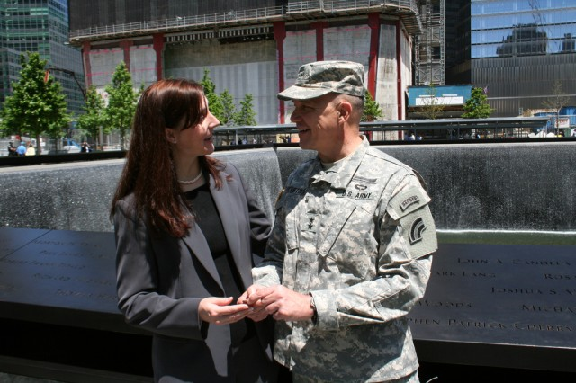 NEW YORK -- New York Army National Guard Maj. Gen. Steven Wickstrom presents a military challenge coin to Jennifer Adams, Chief Executive Officer of the WTC Tribute Center at the site of the World Trade Center Memorial North Tower pool May 18 during a guided tour of the WTC Tribute Center and Memorial site in honor of the New York National Guard's response and recovery efforts after 9/11. U.S. Army photo by Lt. Col. Richard Goldenberg, NY Army National Guard.