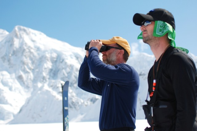 Training Specialist Steven Decker and Instructor Staff Sgt. Brian Bailey, both assigned to the Army's Northern Warfare Training Center, survey the route they will take to the summit of Mount McKinley, Alaska. Grooming standards, such as shaving, are temporarily suspended as a clean shaven face is much more susceptible to damage from frostbite and other extreme conditions they will face on their expected 14-to-20-day climb.