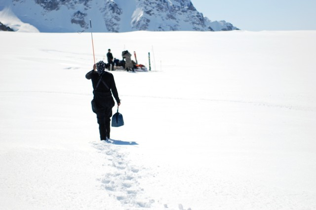 Climb-team members from the U.S. Army Alaska Northern Warfare Training Center probe the depth of the snow and ice on Kahiltna Glacier, Alaska, May 17, 2012, to ensure safe passage before regrouping and beginning their mission.