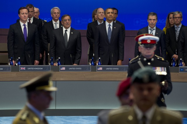 British Prime Minister David Cameron, U.S. Defense Secretary Leon E. Panetta, President Barack Obama and NATO Secretary General Anders Fogh Rasmussen observe a NATO color guard prior to a moment of silence honoring those service members killed at wounded in Afghanistan at the NATO Summit in Chicago, May 20, 2012.