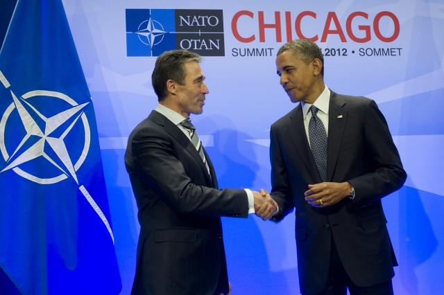 President Barack Obama, right, thanks NATO Secretary General Anders Fogh Rasmussen at the opening of the NATO Summit in Chicago, May 20, 2012.