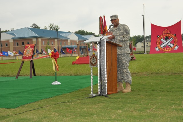 As part of the 200th anniversary celebration of the U.S. Army Ordnance Corps, the parade field on the school's campus was dedicated May 17 in honor of Medal of Honor recipient Maj. Hulon B. Whittington. Col. Greg A. Mason, U.S. Army Ordnance School commandant, addresses the audience to explain the important role of ordnance Soldiers and the vital support they provide to the military. (U.S. Army photo by H.S. Block)