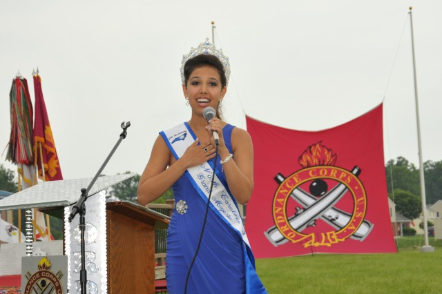 Victoria Huggins, North Carolina Teen Grand Majestic Queen, sang the national anthem during the Maj. Hulon B. Whittington parade field dedication May 17. Huggins' father is an ordnance senior noncommissioned officer in the National Guard. (U.S. Army photo by H.S. Block)