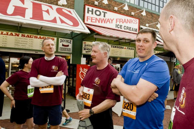 Sgt. David Arvizo (in blue) stands with Soldiers from the U.S. Army Institute of Environmental Medicine before the Run-Walk to Homebase at Fenway Park, May 20, 2012. About a dozen active duty Soldiers and civilians from Natick Soldier Systems Center in Natick Mass., joined the nearly 2,000 runners and walkers who participated in the Red Sox Run-Walk to Home Base. The Run-Walk to Home Base is a unique 9-kilometer fundraising run and three-mile walk which helps raise money for the Red Sox Foundation and Massachusetts General Hospital Home Base Program.