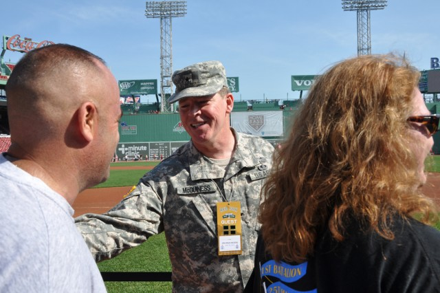 Brig. Gen. John McGuiness, commanding general of the Natick Soldier Systems, helped congratulate runners as they started and finished the 2012 Red Sox Foundation Run.Walk to Home Base. There were more than a dozen runners representing NSSC. The Run to Home Base raised more than $10 million in the three years the Red Sox Foundation has had the run. The Home Base Program is a partnership between the Red Sox Foundation and Mass General Hospital to research Post Traumatic Stress Disorder and Traumatic Brain Injuries.