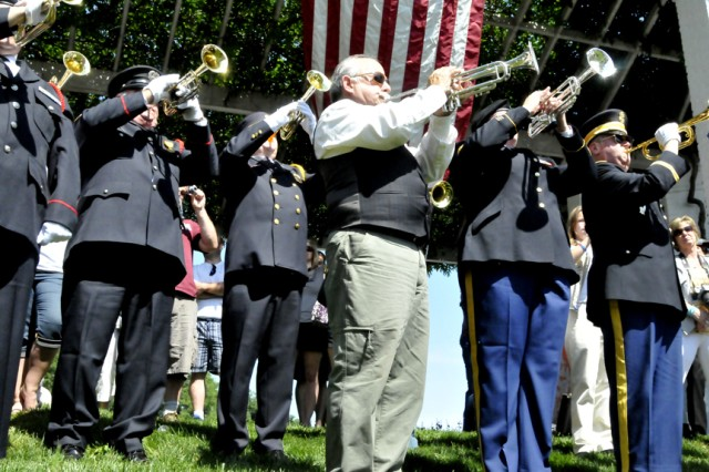 Buglers from across the nation gathered at Arlington National Cemetery, May 19, 2012, to honor the 150th anniversary of taps. At the end of the ceremony, 200 buglers fanned out throughout the cemetery for a noon collective sounding of the bugle call.