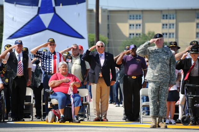 Nearly 700 Vietnam veterans, including Medal of Honor Recipient Michael Thornton (center) and retired Gen. Robert Shoemaker (far right), render honors during the national anthem as it was played during the Vietnam Veterans Welcome Home Ceremony at Fort Hood, Texas, May 21, 2012.