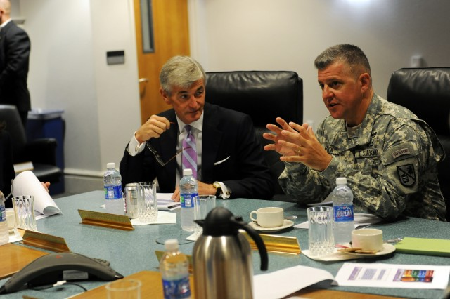 Secretary of the Army John McHugh sits in a command briefing with Defense Language Institute Foreign Language Center Commandant Col. Danial D. Pick and his staff May 21, 2012, during a visit to the Presidio of Monterey.