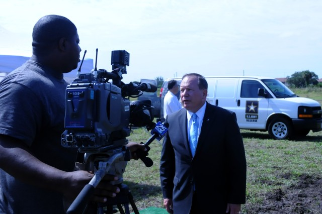 Chief Executive Officer of the Army Reserve Tad Davis speaks to a reporter from WPBF channel 25 about the ground breaking for a new 64,514 sq. ft. Army Reserve Center in southern Florida on May 19. The project will cost approximeately $16 million and should be completed in the summer of 2013.